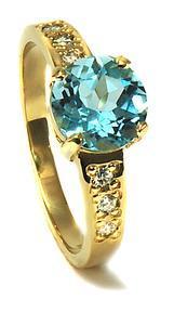 Zlatý prsten s diamanty a topazem PD2001
