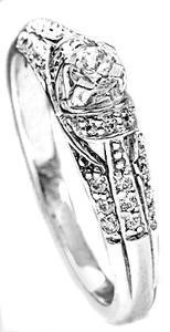 Zlatý prsten se zirkony P626